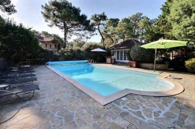 Location VILLA ARCACHON LE MOULLEAU 5 chambres - 12 personnes - avec piscine chauffée
