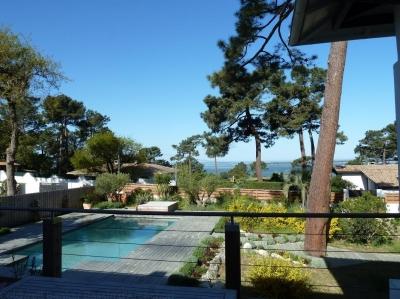 Location VILLA PYLA SUR MER   7 chambres - 14 personnes - piscine chauffée et vue bassin